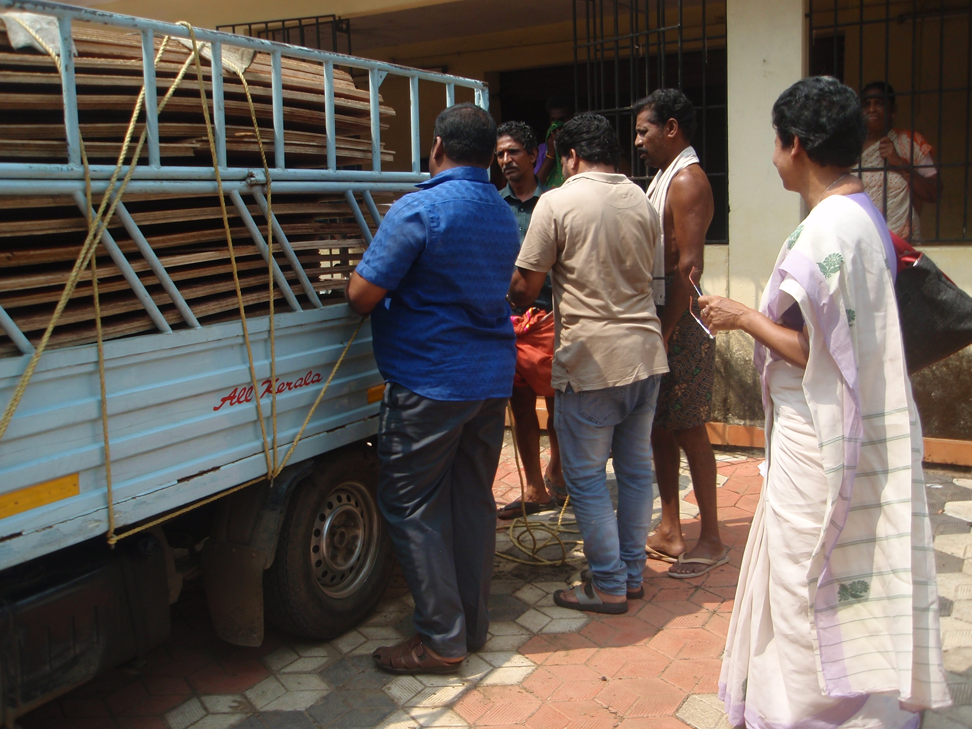 Sr.Regy with people in Distribution of plywood at Kosamattam colony
