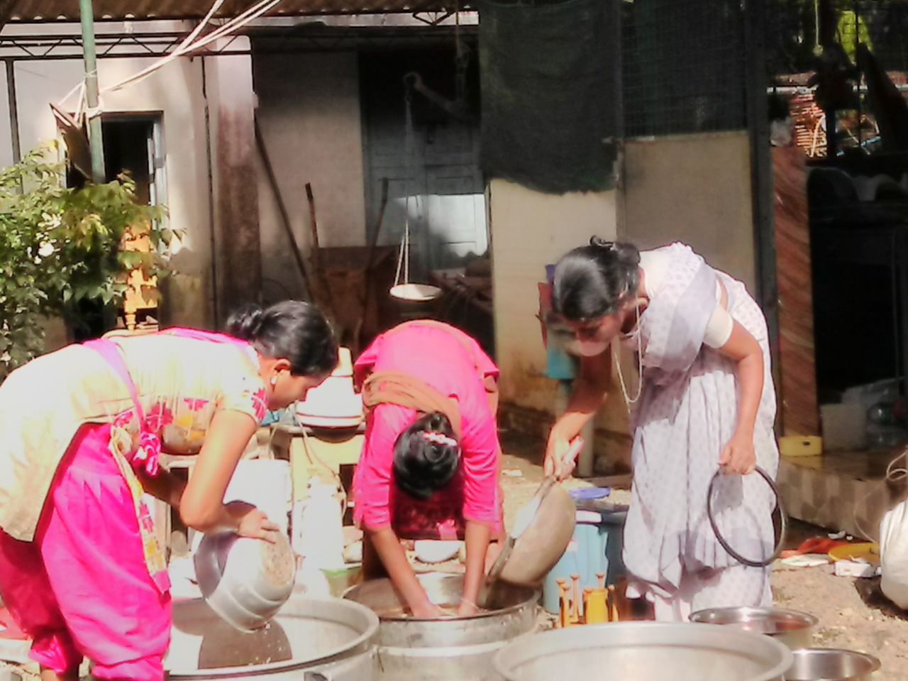 Sr.Valsamma helps in cleaning  a house after floods